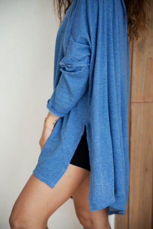 Side view Tunic length cowl top slightly longer in the back covers bum